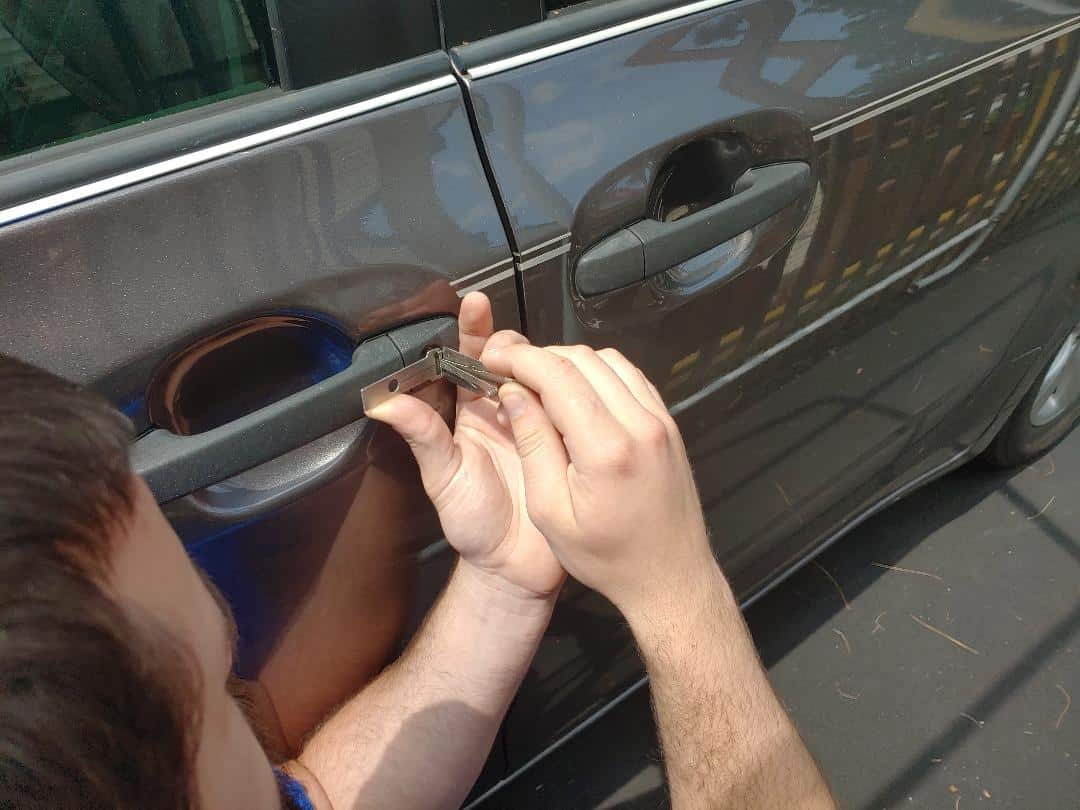 image of a car door lock being picked