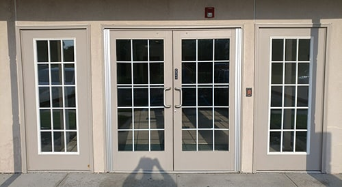 Double doors at Newtown Office Complex that we repaired